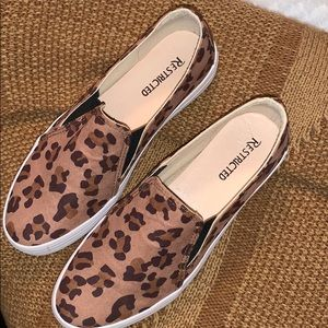 Size 8 leopard print slip on shoes by Restricted